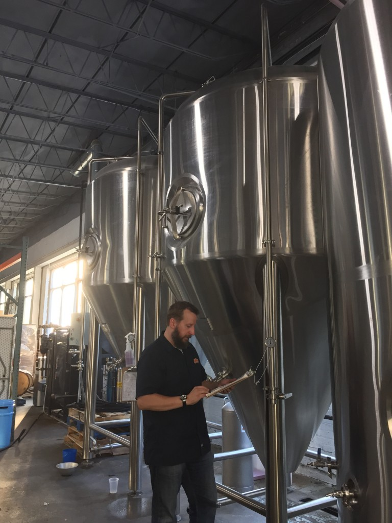 Dan checks in on the brewery's two forty-gallon fermenters.