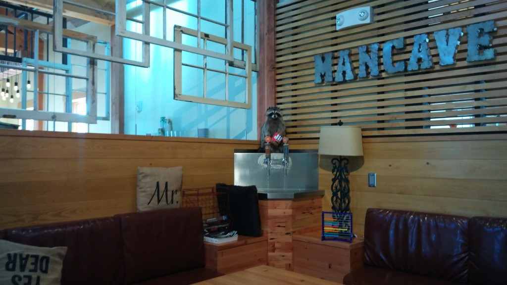 In the Farm House, are several lounging areas such as the Mancave. The Mancave has reclaimed window frames around and a self-serve tap where customers use an abacus to track drinks poured.