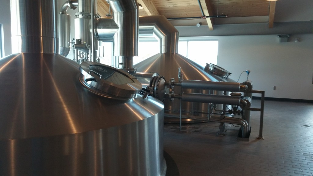 The vapor condenser recaptures steam during the brewing process, turning it into hot water and returning it back into the brewing process.