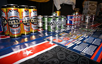 Variations of Oskar Blues Beer in Cans on table