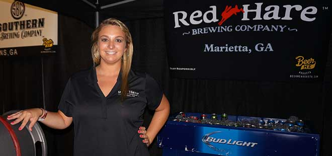 Red Hare Brewing rep poses for photo at beer booth