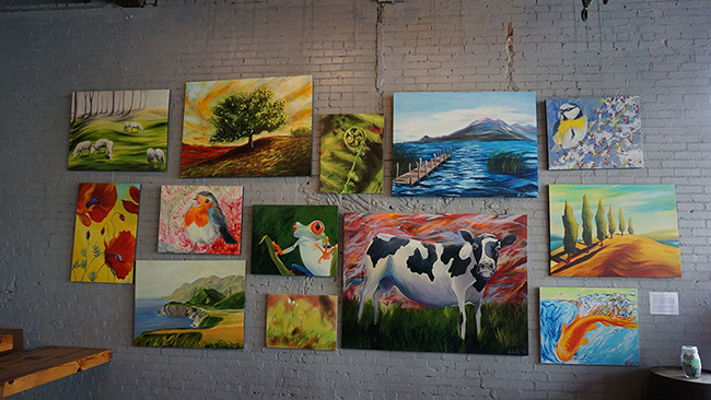 Reproductions of Sara Papp's work on display at Creature Comforts Brewing Co. in Athens, Georgia. (Photo: John Pylant)