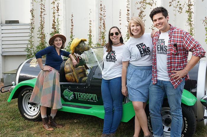My Athens representatives posing next to Terrapin Beer Co. car