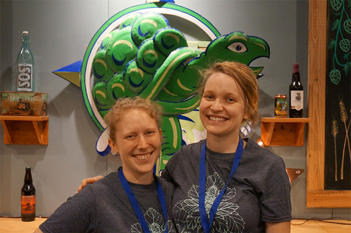 Two Terrapin employees smiling behind Gift Shop Counter