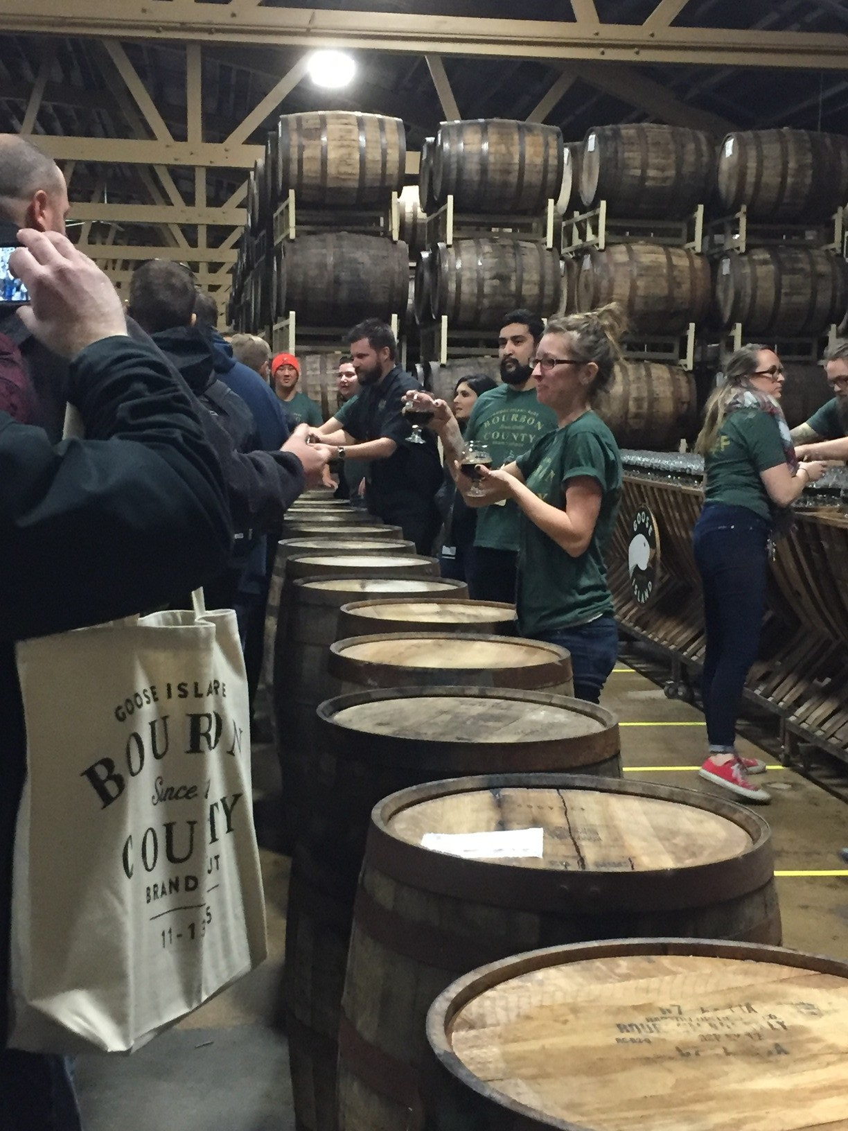 Goose Island employees hand out the Rare samples as people entered the Barrel House.