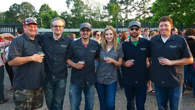 GrassLands Brewing Co. founders Gabe and Sara Grass, center, and the rest of the brewery crew. (Facebook)