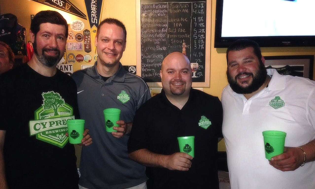 From left to right: Moshe Atzbi (Manager of Haileys Harp & Pub), Cypress Brewing co-owners Jason Kijowski, Bill Lutz and Charles Backmann (head brewer, co-owner)