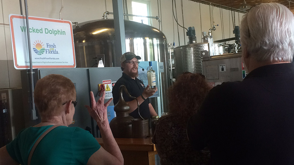 Assistant distiller Matt Loiselle gives a packed tour of Wicked Dolphin.