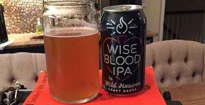 Wild Heaven Wise Blood IPA can and glass atop orange O'Connor novel