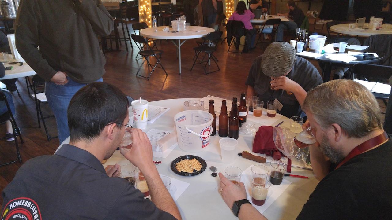 "(Certified Judges hard at work deciding ""Best of Show"" winners in IPA Category; Photo by Scott Johnson)"