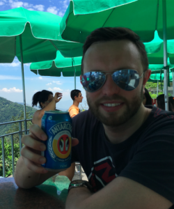 My husband and I grabbing a quick Antarctica at the top of Cristo Redentor.