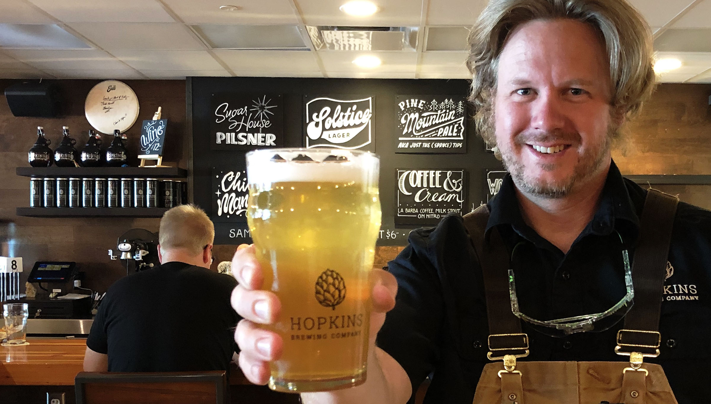 Chad Hopkins, brewer at Hopkins Brewing Co. in Salt Lake City, and a pint of his Sugar House Pilsner. He grew up a mile from where his brewpub now stands.