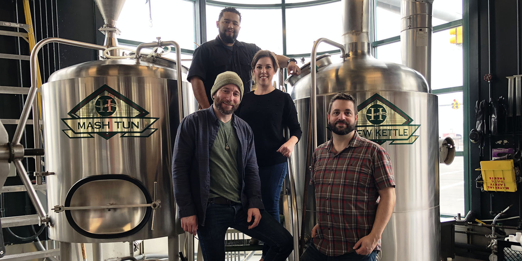 From left, Brock Blonquist, general manager; Richard Rodriguez, brewer; Natalie Rogers, marketing director; and Donovan Steele, head brewer.