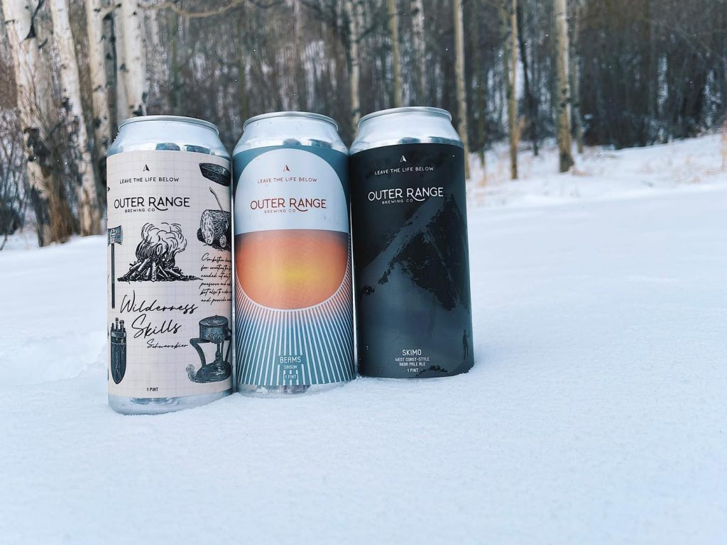Outer Range Brewing cans in snow